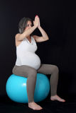 Pregnant woman and gym ball Stock Image
