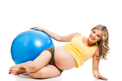 Pregnant woman with gymnastic ball Stock Images