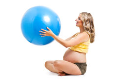Pregnant woman with gymnastic ball Stock Photo