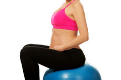 Pregnant woman with gymnastic ball Stock Image