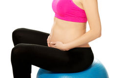 Pregnant woman with gymnastic ball Royalty Free Stock Photos