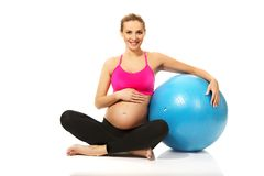 Pregnant woman with gymnastic ball Royalty Free Stock Images