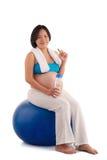 Pregnant woman on gymnastic ball Stock Image
