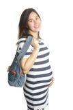 A pregnant woman with handbag Stock Photo