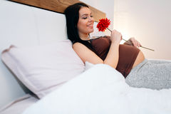 Pregnant woman happy for flower Stock Photos