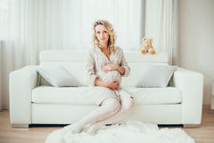 A pregnant woman. A happy pregnant woman in interior royalty free stock images