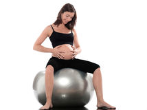 Pregnant Woman Happy sitting on swiss ball fitness stock image