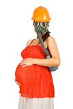 Pregnant woman in hardhat and gas-mask Royalty Free Stock Image