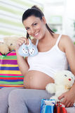 Pregnant woman has bought things for your baby Royalty Free Stock Image
