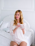 The pregnant woman has morning coffee. Stock Photography