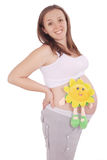 Pregnant woman has put the toy to the stomach Stock Photo