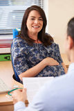 Pregnant Woman Having Appointment With Doctor In Surgery Royalty Free Stock Photography