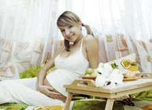 Pregnant woman having breakfas Stock Photography