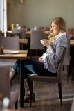 Pregnant Woman Having Coffee Royalty Free Stock Photography