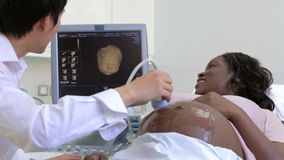 Pregnant Woman Having 4D Ultrasound Scan stock footage