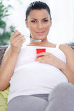 Pregnant woman having a healthy snack,  fruit yogurt Royalty Free Stock Photo