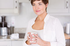 Pregnant woman having a hot drink Stock Photography