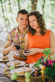 Pregnant woman having lunch with her husband in a forest Stock Image