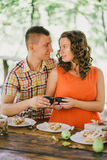Pregnant woman having lunch with her husband in a forest Royalty Free Stock Photos