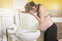 Pregnant woman having morning sickness during Pregnancy. Concept Royalty Free Stock Photography