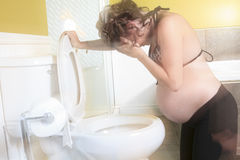 Pregnant woman having morning sickness during Royalty Free Stock Photography