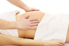 Pregnant woman having a relaxing massage. Pregnant woman having a massage on her belly Royalty Free Stock Photos