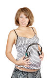 Pregnant woman with headphones Stock Photography