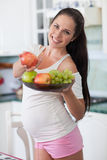 Pregnant woman and healthy food Royalty Free Stock Image