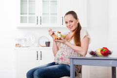 Pregnant woman and healthy food. Royalty Free Stock Photos