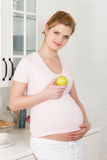 Pregnant woman and healthy food Stock Photography