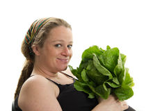 Pregnant woman healthy food lettuce isolated Stock Photography