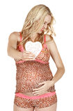 Pregnant woman with heart. Stock Photo