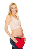 Pregnant woman with a heart pillow Royalty Free Stock Photo
