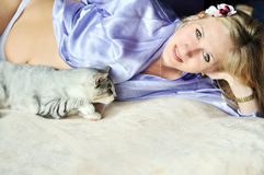 Pregnant woman with her cat Royalty Free Stock Photos