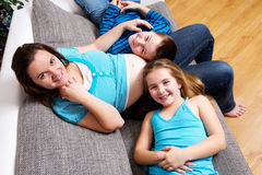 Pregnant woman with her children Royalty Free Stock Photos