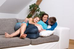 Pregnant woman with her children Stock Photo