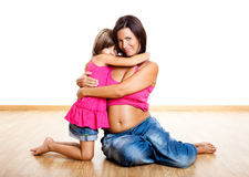 Pregnant woman with her daughter Royalty Free Stock Photos