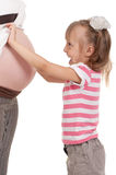 Pregnant woman with her daughter stock image