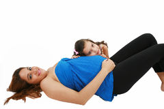 Pregnant woman and her daughter Royalty Free Stock Image