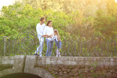 Pregnant woman with her daughter and husband on a walk in the Park on a Sunny day Stock Image