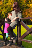 Pregnant woman with her daughter in park outdoor Royalty Free Stock Photos