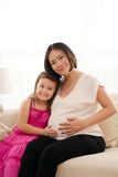 Pregnant woman and her daughter Stock Image