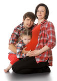 Pregnant woman with her family Stock Photos