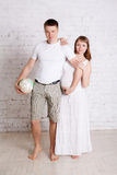 Pregnant woman and her fun husband with soccer ball Royalty Free Stock Photos