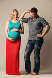 Pregnant woman with her husband Stock Image