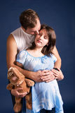 Pregnant woman and her husband embracing Stock Photos