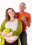 The pregnant woman with her husband and  green apple Royalty Free Stock Images