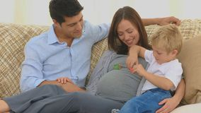 Pregnant woman with her husband and her son stock footage