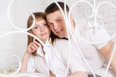 Pregnant woman with her husband at home Royalty Free Stock Images