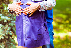Pregnant woman and her husband in the park Stock Image